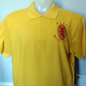 yellow rlsc with pride badge